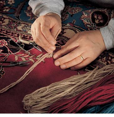 rug repair_hands